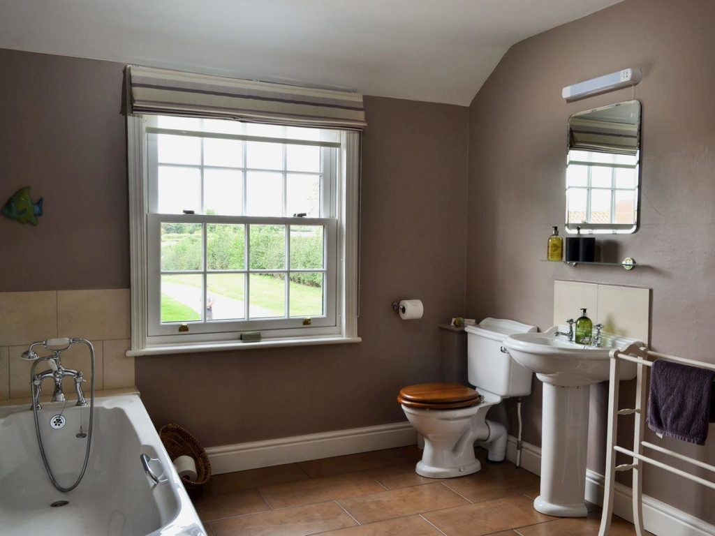 Bathroom large, but cosy with bath, separate shower cubicle, WC and basin