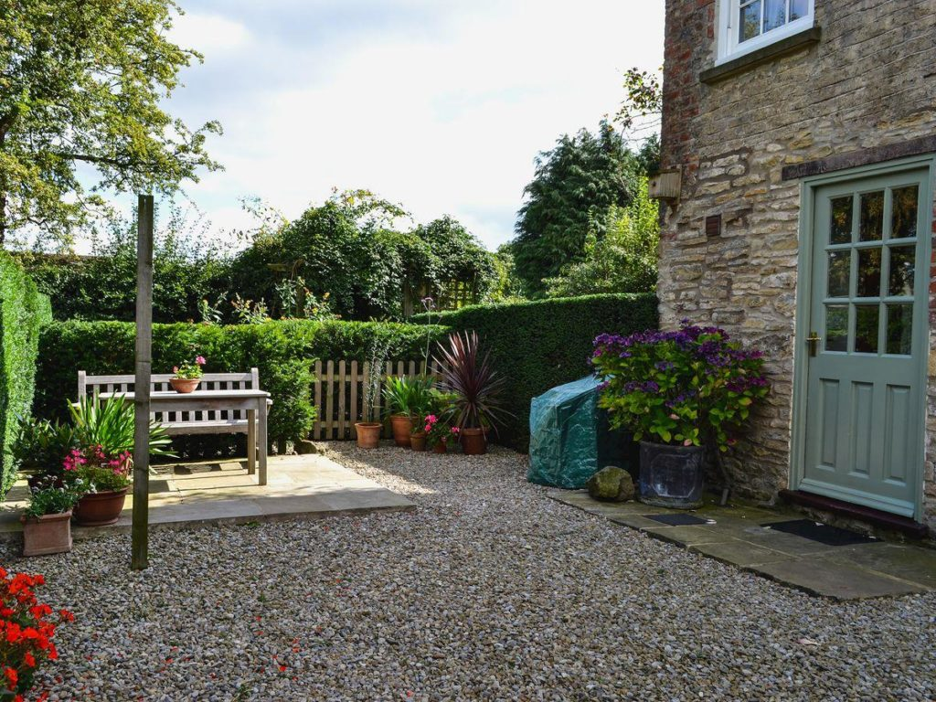 Courtyard garden:  sunny private gravelled courtyard garden.  Gate to yard where guests park their car